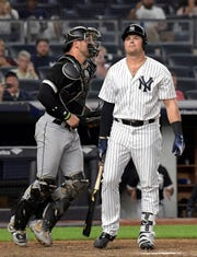 Chicago White Sox catcher Kevan Smith celebrates as New York Yankees pinch-hitter Luke Voit, right, reacts after striking out to end the baseball game Wednesday, Aug. 29, 2018, at Yankee Stadium in New York. The White Sox won 4-1.