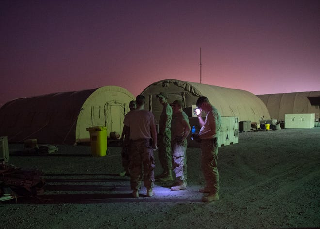 Airmen from the 49th Materiel Maintenance Squadron structures team, discuss a game plan before tearing down tents Aug. 9, 2018, at Abdullah Al Mubarak Air Base, Kuwait. The team specializes in maintaining, inventorying, erecting and disassembling tents of all forms.