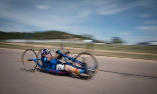 Master Sgt. Lisa Goad, Department of Defense Warrior Games athlete and Team Air Force member, competes in the cycling competition at the U.S. Air Force Academy, Colorado Springs, Colorado, June 6, 2018. Competing in the Games are service members and veterans with upper-body and lower-body limitations, spinal cord injuries, traumatic brain injuries, visual impairments, serious illnesses, and post-traumatic stress. Each of the Air Force's 39 participating athletes will compete in one or more of 11 sports including archery, cycling, shooting, sitting volleyball, swimming, track and field, and wheelchair basketball, indoor rowing, powerlifting, and time-trial cycling.