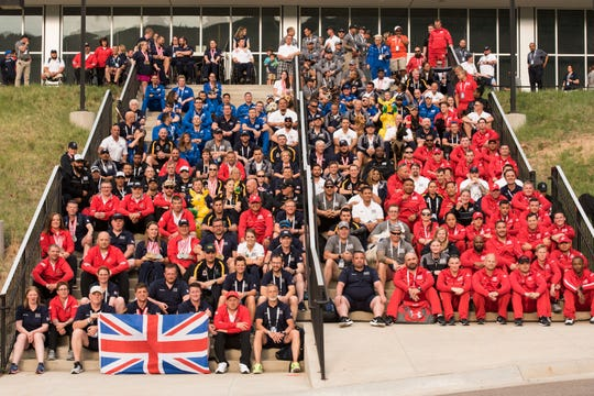 Athletes and staff pose for a team photo at the conclusion of the 2018 DoD Warrior Games at the U.S. Air Force Academy in Colorado Springs on June 9, 2018.  The Warrior Games are an annual event, established in 2010, to introduce wounded, ill and injured service members to adaptive sports as a way to enhance their recovery and rehabilitation.     (DoD Photo by Roger L. Wollenberg)