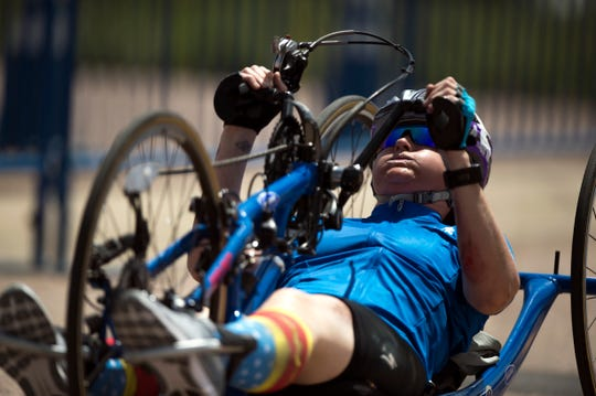 Team Air Force Master Sgt. Lisa Goad powers a hand cycle during the 2018 DoD Warrior Games time trials competition at the Air Force Academy in Colorado Springs, Colo. June 6, 2018. (DoD photo by EJ Hersom)