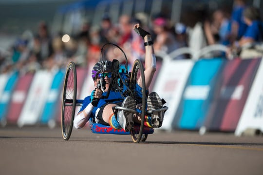 Team Air Force Master Sgt. Lisa Goad reacts to finishing the 2018 DoD Warrior Games cycling competition at the Air Force Academy in Colorado Springs, Colo. June 6.