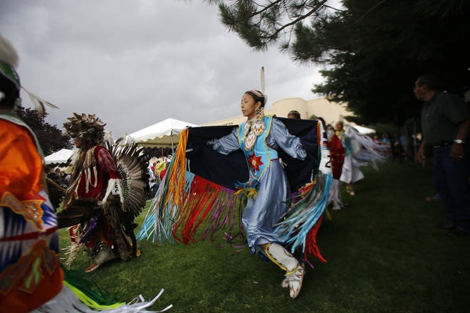 A shawl dancer participates in the grand entry Sept. 5, 2016, during the Totah Festival at the Farmington Civic Center. This year's event takes place this weekend at the Farmington Museum at Gateway Park.