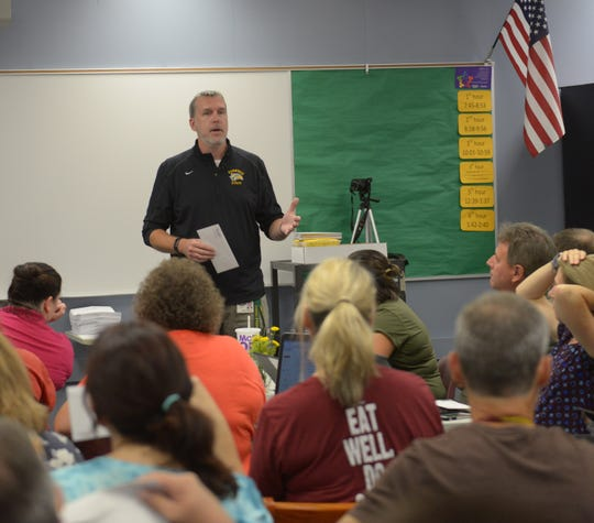 Harrison Principal Jim Anderson welcomes teachers back Aug. 27, the staff's first day.