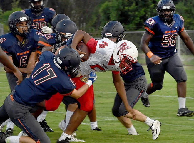 Beau Chene tacklers move in to stop a Port Barre ball carrier during last Friday's St. Landry Parish Jamboree game at Donald Gardner Stadium.