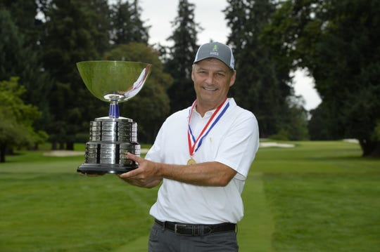 Jeff Wilson holds the Frederick L. Dold Trophy after winning his match 2 and 1 over Jeff Wilson during the final round at the 2018 U.S. Senior Amateur at Eugene Country Club in Eugene, Ore. on Thursday, Aug. 30, 2018.  (Copyright USGA/J.D. Cuban)