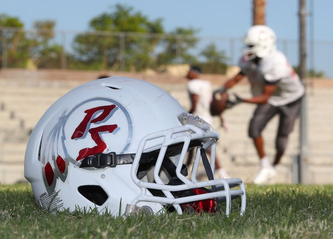The helmet is a vital piece of equipment to reduce head injuries to football players.  This one is a helmet from Palm Springs High School during practice, August 29, 2018.