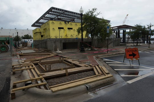 Construction continues Thursday on downtown Pensacola's ferry terminal building and dock at Commendencia Slip.