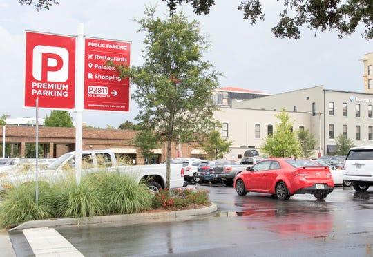 A vehicle drives through the Premium Parking lot on S Baylen Street in downtown Pensacola on Thursday, August 30, 2018.