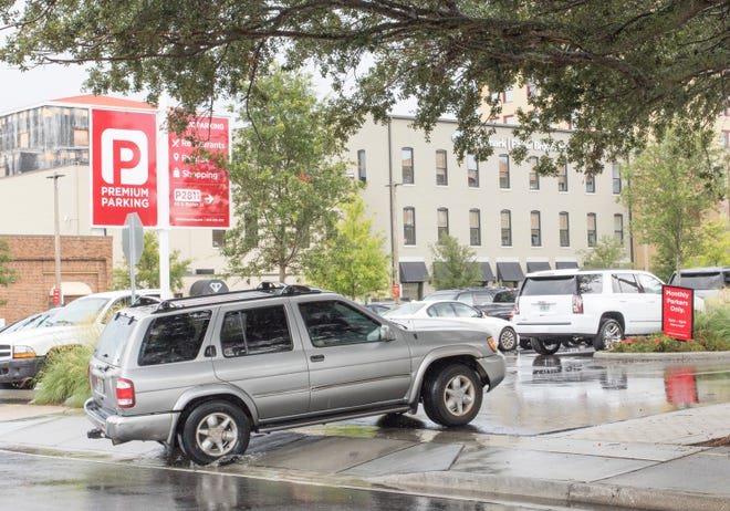 A vehicle drives into the Premium Parking lot on South Baylen Street in downtown Pensacola on Thursday.