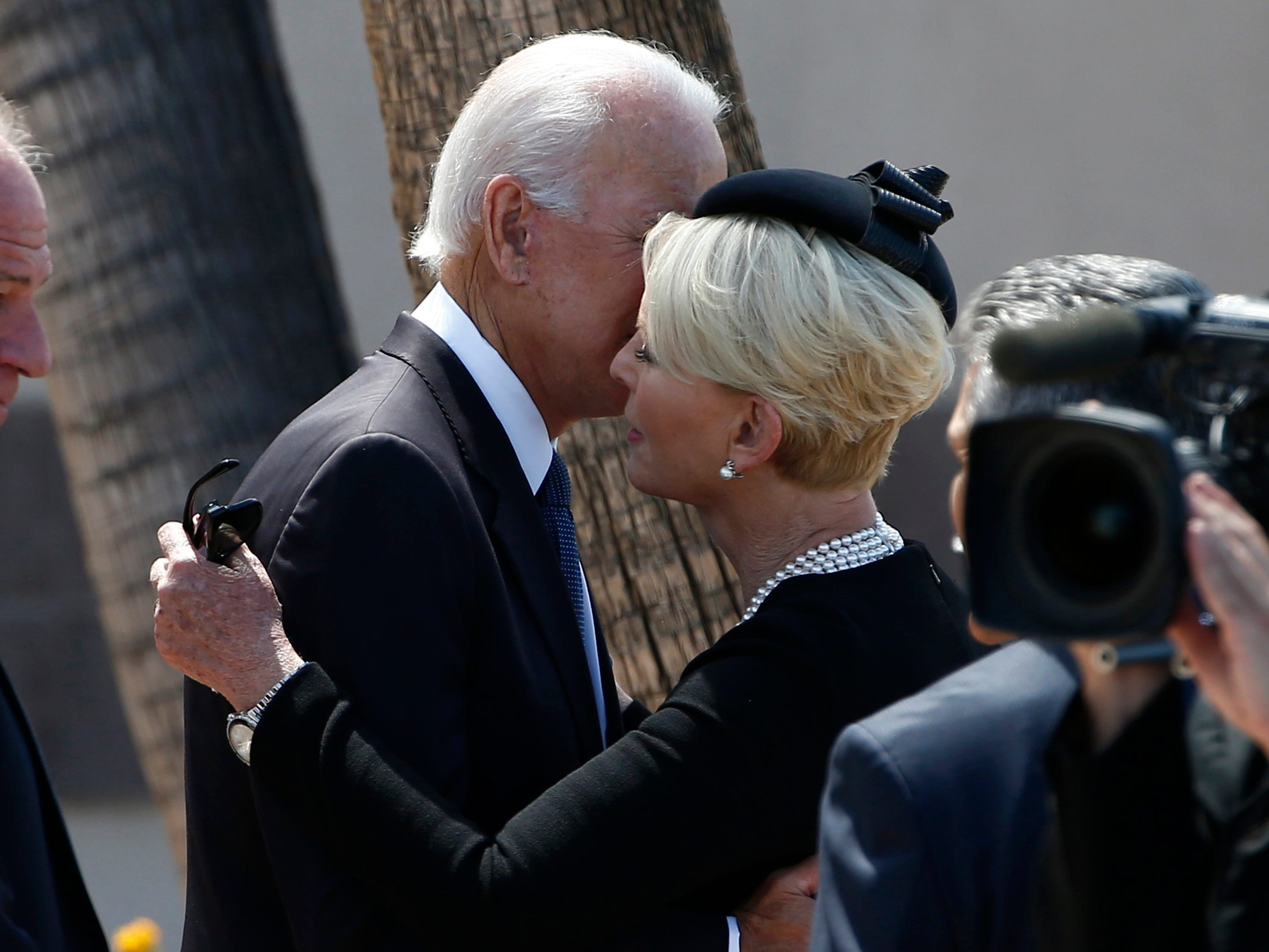 Cindy McCain, right, wife of Sen. John McCain, R-Ariz., gets a hug from former Vice President Joe Biden, left, after a memorial service for McCain at North Phoenix Baptist Church, Aug. 30, 2018, in Phoenix.