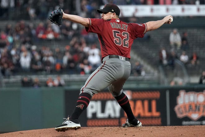 Aug 29, 2018; San Francisco, CA, USA; Arizona Diamondbacks starting pitcher Zack Godley (52) pitches against the San Francisco Giants during the first inning at AT&T Park.