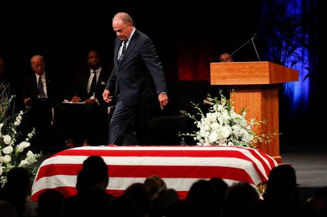 Grant Woods walks from the podium after giving a tribute during a memorial service at North Phoenix Baptist Church for Sen. John McCain, R-Ariz., on Thursday, Aug. 30, 2018, in Phoenix.