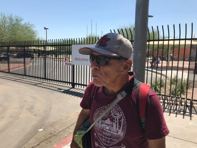 Arthur Montoya, 67, is searching for shelter for the night just blocks from the state Capitol, where John McCain lies in state on Aug. 29, 2018.