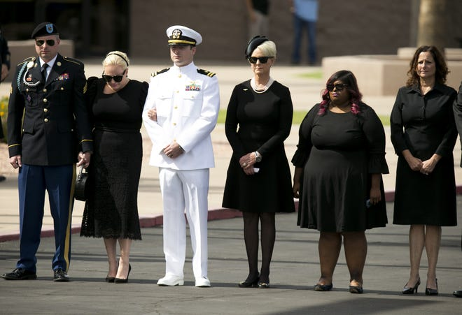 Senator John McCain's family, (from left) Jimmy McCain, Meghan McCain, Jack McCain, Cindy McCain, Bridget McCain and Sidney McCain, look on before a memorial service for Sen. John McCain at North Phoenix Baptist Church in Phoenix on Aug. 30, 2018.