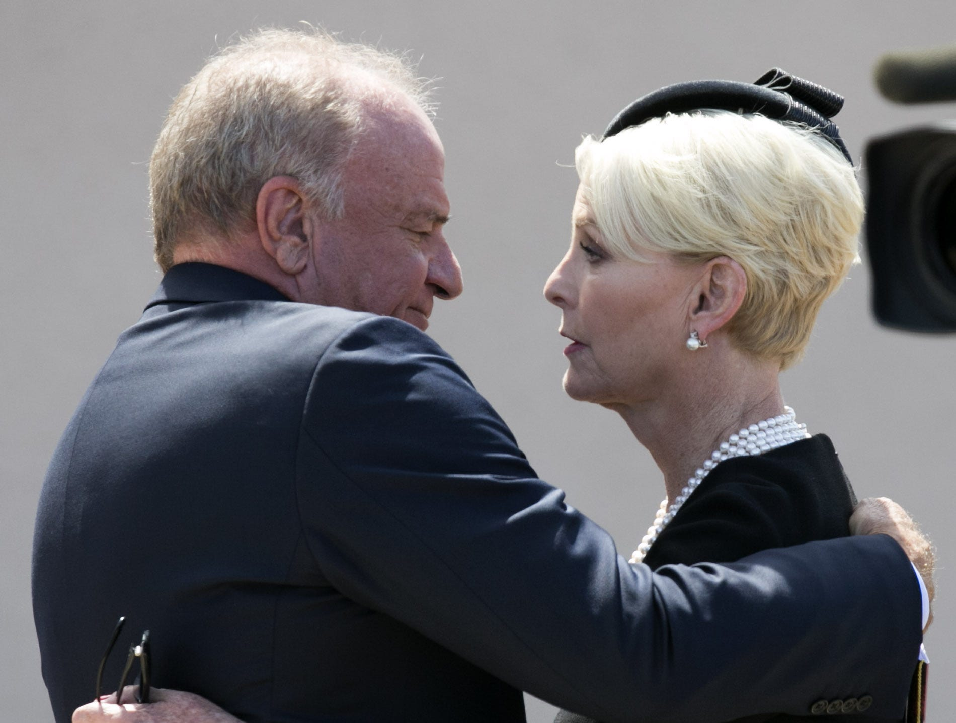 Grant Woods, a former Arizona attorney general and longtime McCain family friend, hugs Cindy McCain at North Phoenix Baptist Church in Phoenix, Aug. 30, 2018.