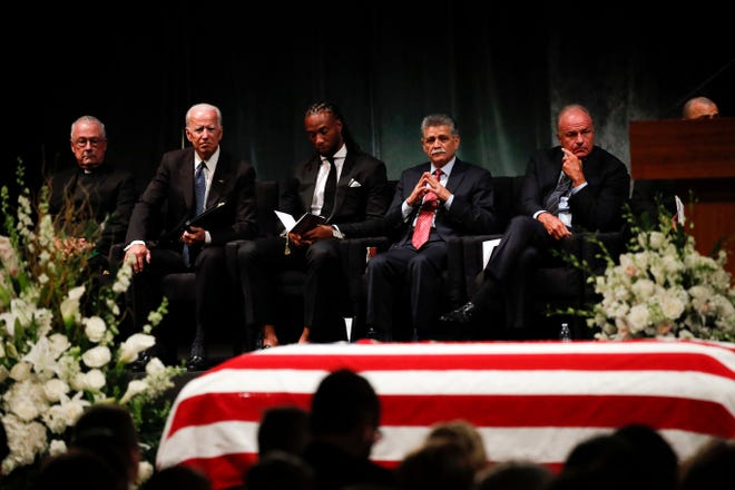 Father Edward Reese, from left, Vice President Joe Biden, Larry Fitzgerald, Tommy Espinoza, and Grant Woods wait to speak during memorial service at North Phoenix Baptist Church for Sen. John McCain, R-Ariz., on Thursday, Aug. 30, 2018, in Phoenix.
