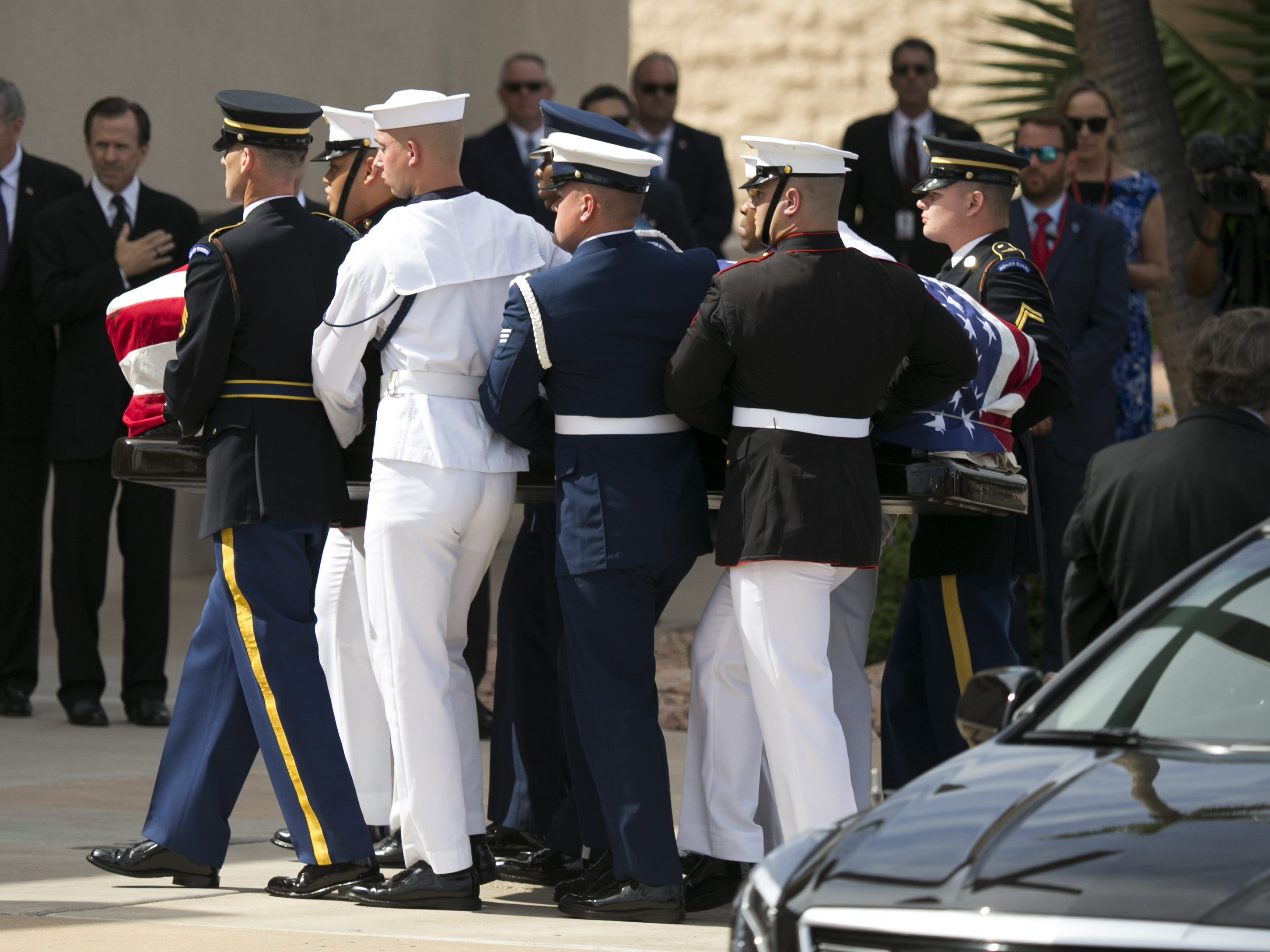 Senator John McCain's flag draped casket is carried by members of the United States military during a memorial service for Senator John McCain at North Phoenix Baptist Church in Phoenix, Aug. 30, 2018.