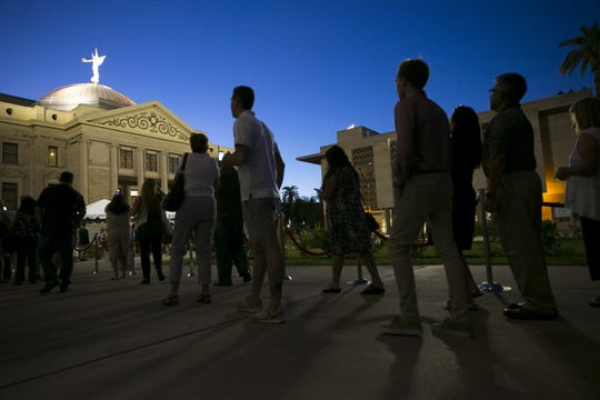 People wait in line to enter the Arizona Capitol to pay their respects where Senator John McCain lies in state in Phoenix on Wednesday, August 29, 2018.