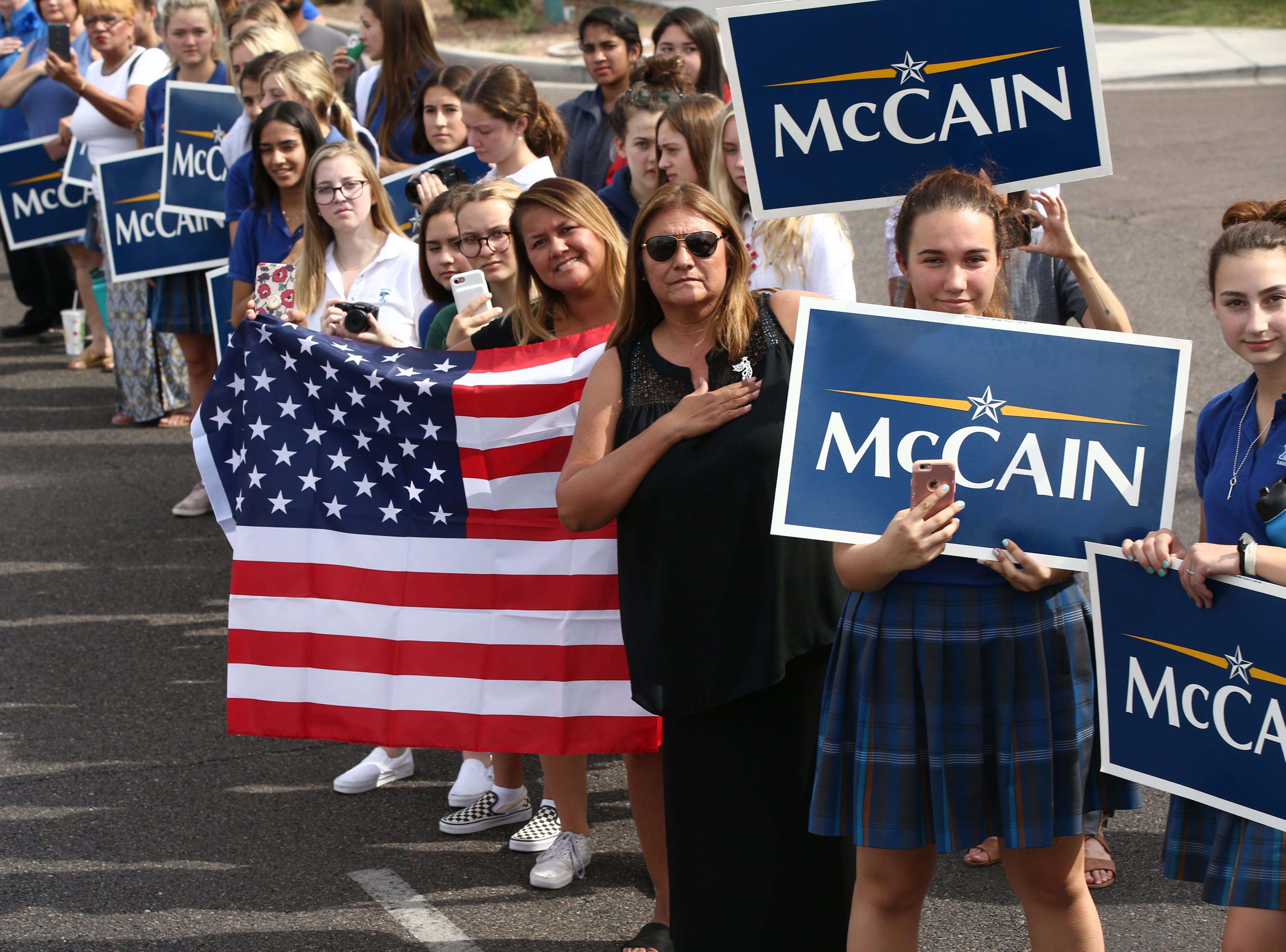 Thousands lined the streets to pay their final respects as the hearse of U.S. Senator John McCain traveled to his memorial service at North Phoenix Baptist Church on Aug. 30, 2018,in Phoenix.