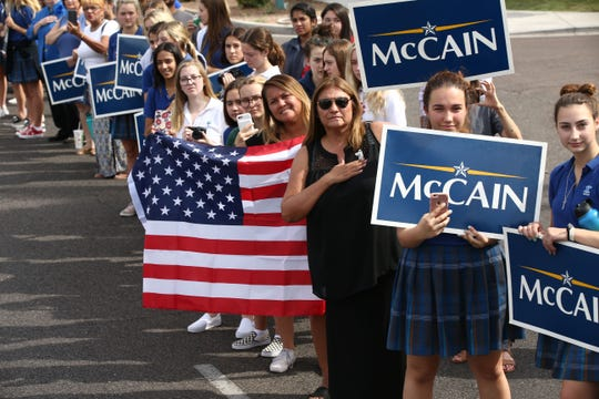 Thousands lined the streets to pay their final respects as the hearse of U.S. Senator John McCain traveled to his memorial service at North Phoenix Baptist Church on Aug. 30, 2018, in Phoenix.