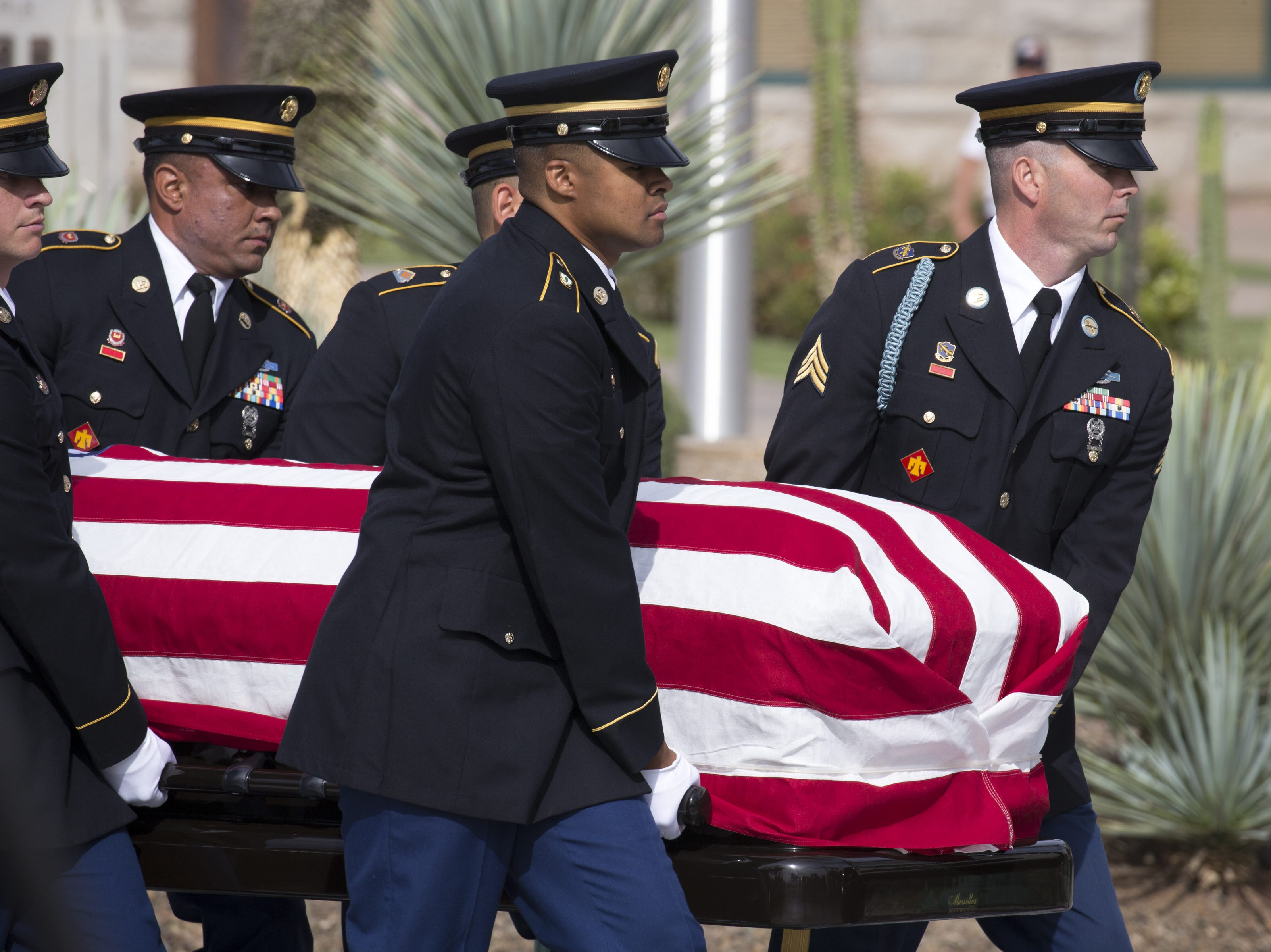 The casket carrying the body of John McCain leaves the Arizona State Capitol, Aug. 30, 2018, for the memorial service at North Phoenix Baptist Church, Phoenix, Arizona.