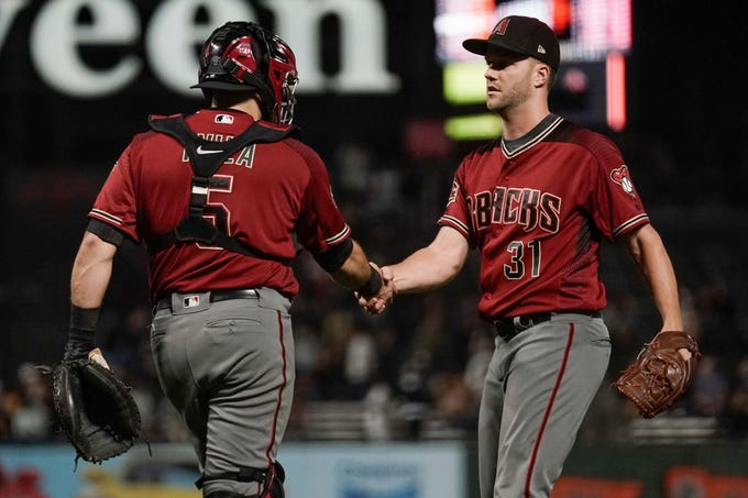 Aug 29, 2018; San Francisco, CA, USA; Arizona Diamondbacks catcher Alex Avila (5) celebrates with relief pitcher Brad Boxberger (31) after defeating the San Francisco Giants at AT&T Park.