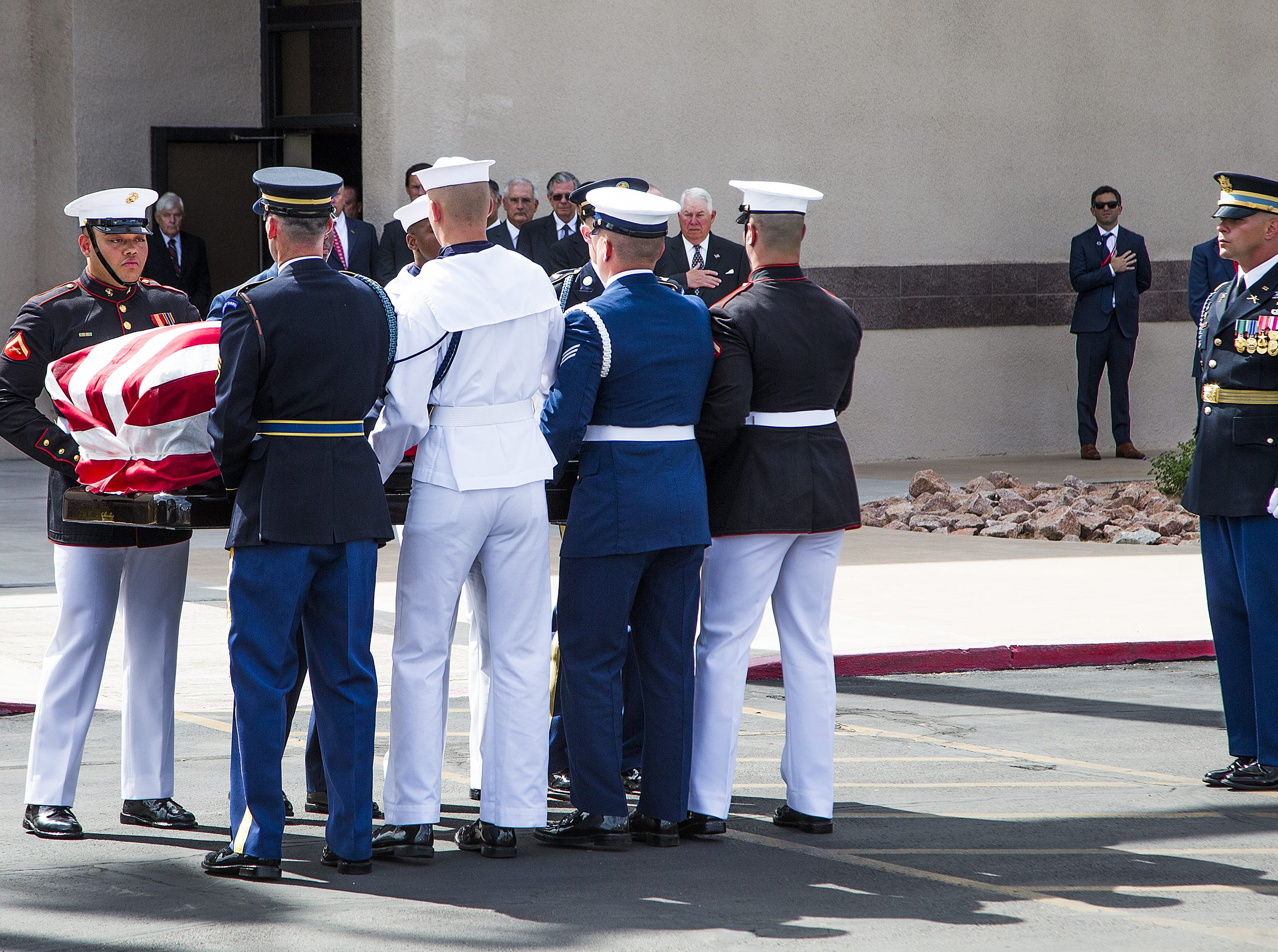 The casket of Sen. John McCain is taken from the hearse at the North Phoenix Baptist Church in Phoenix, Aug. 30, 2018.