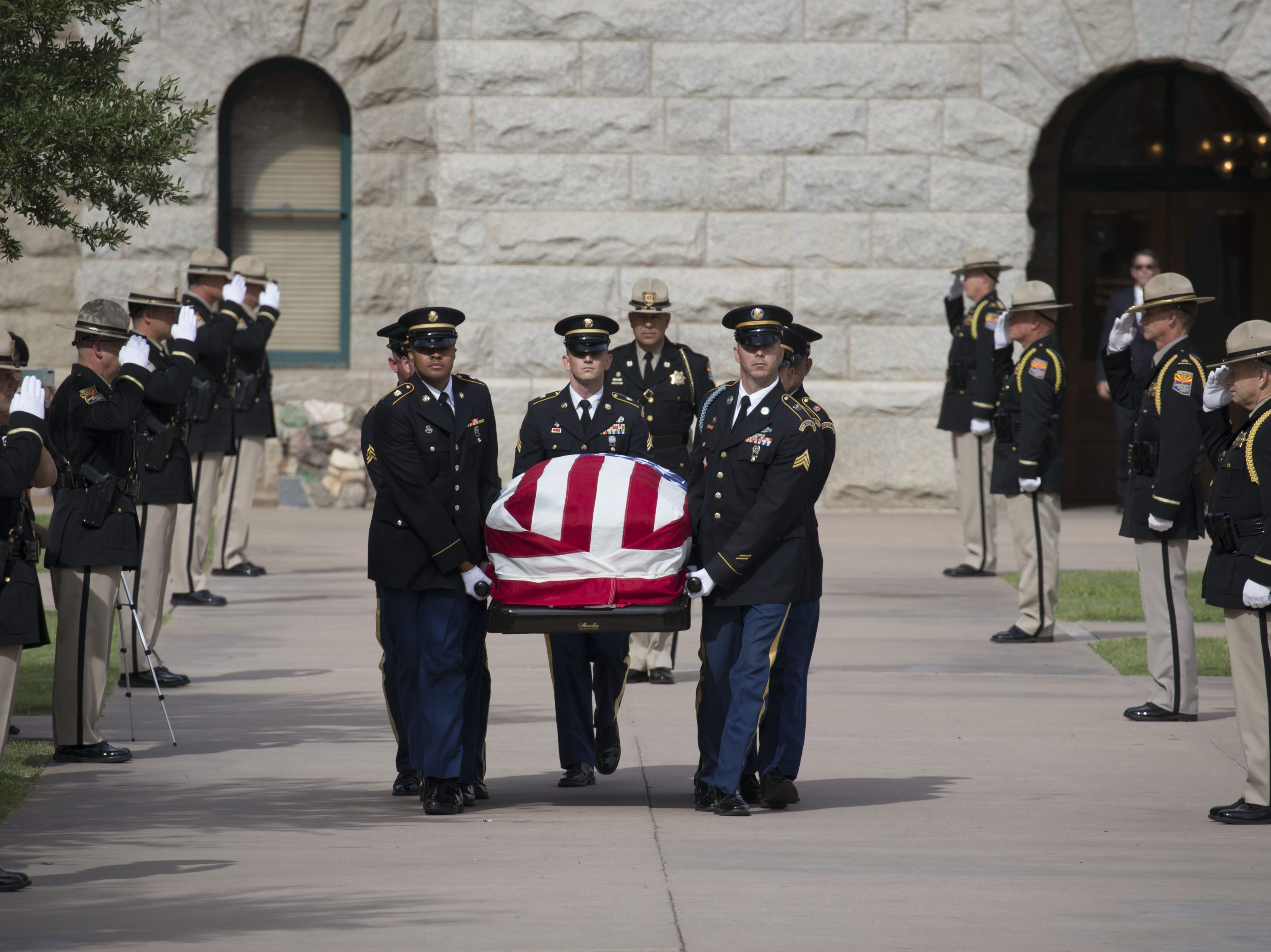 The casket carrying the body of John McCain leaves the Arizona State Capitol, August 30, 2018, for the memorial service at North Phoenix Baptist Church, Phoenix, Arizona.