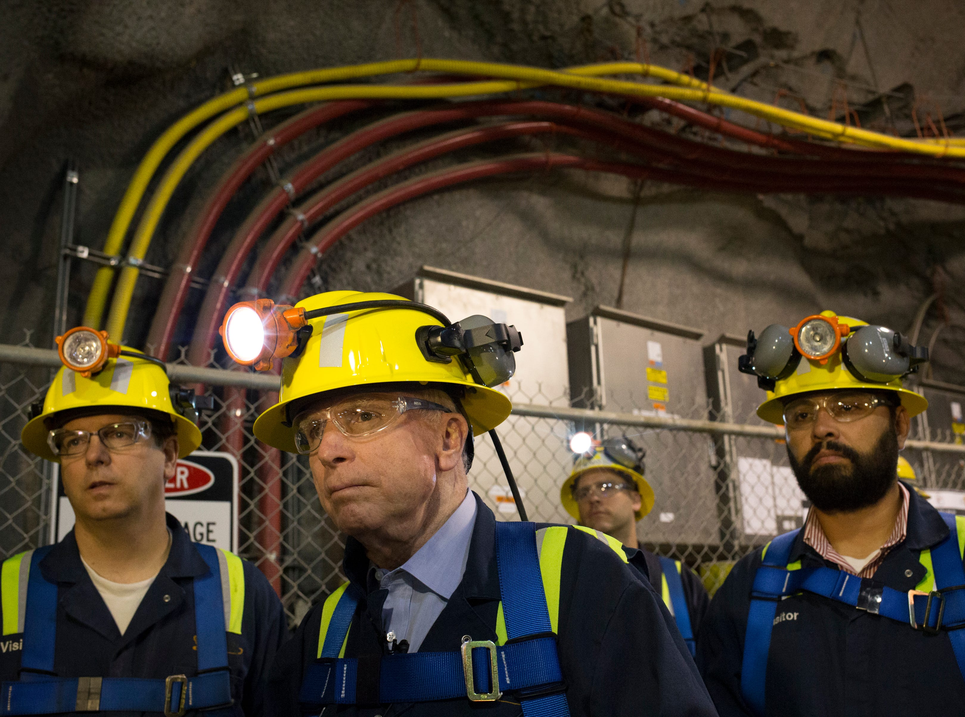 "Sen. John McCain (second from left) tours on Oct. 7, 2014, the ""never sweat tunnel,"" 1,200 feet below the surface in the East Plant at Superior's Resolution Copper."