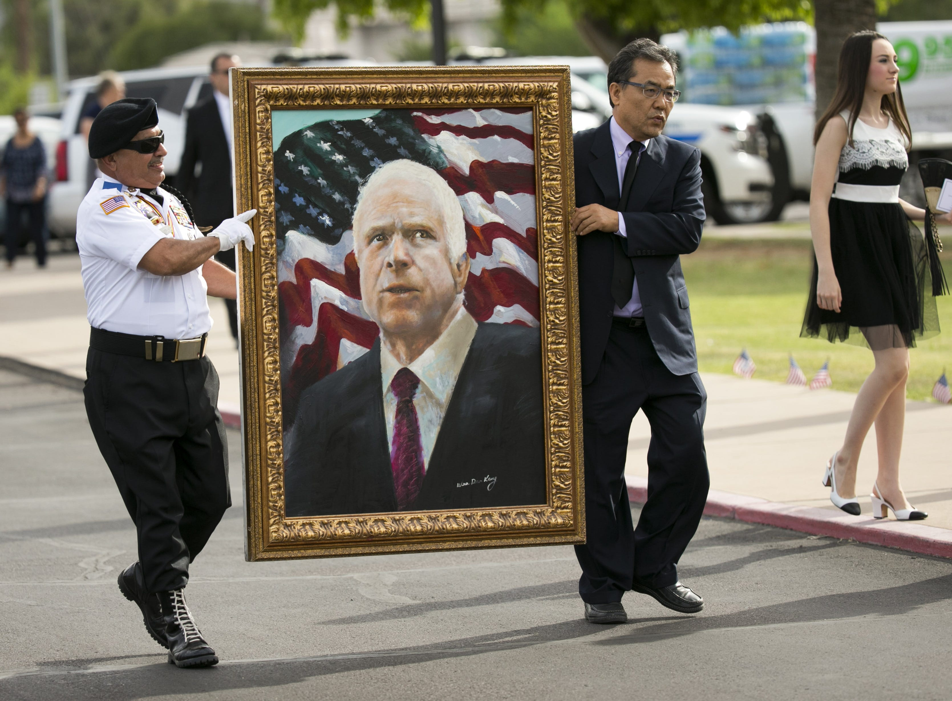 A portrait of Sen. John McCain is carried to North Phoenix Baptist Church before McCain's memorial service at North Phoenix Baptist Church in Phoenix on Aug. 30, 2018.