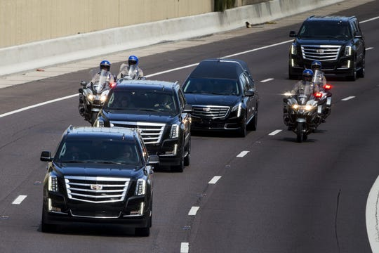 The motorcade escorting Sen. John McCain's body drives south on SR-51 on the way to Sky Harbor Airport on Thursday, Aug. 30, 2018, in Phoenix.