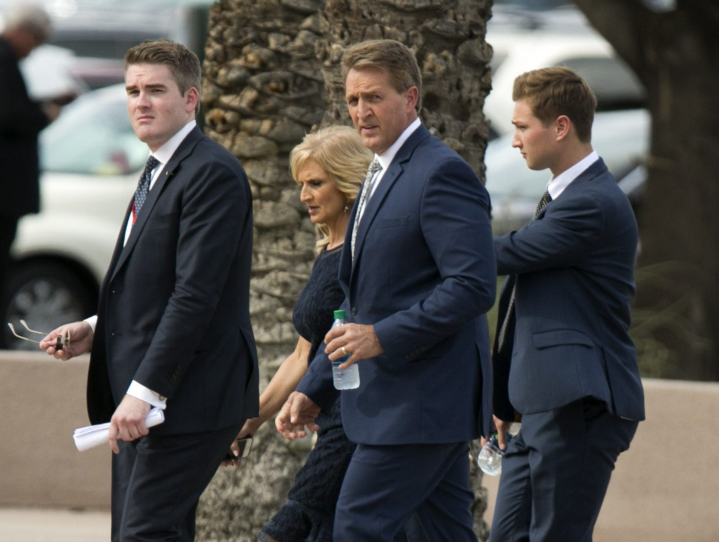 Senator Jeff Flake walks towards the entrance of North Phoenix Baptist Church before a memorial service for Senator John McCain in Phoenix Aug. 30, 2018.