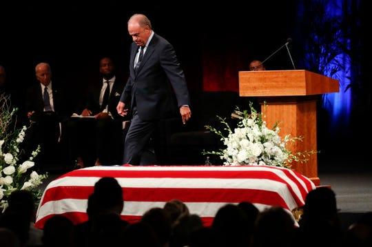 Grant Woods walks from the podium after giving a tribute during a memorial service at North Phoenix Baptist Church for Sen. John McCain, R-Ariz., Aug. 30, 2018, in Phoenix.