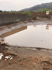 During monsoon storms, the Hoaglin's Ahwatukee yard floods from water running down South Mountain.