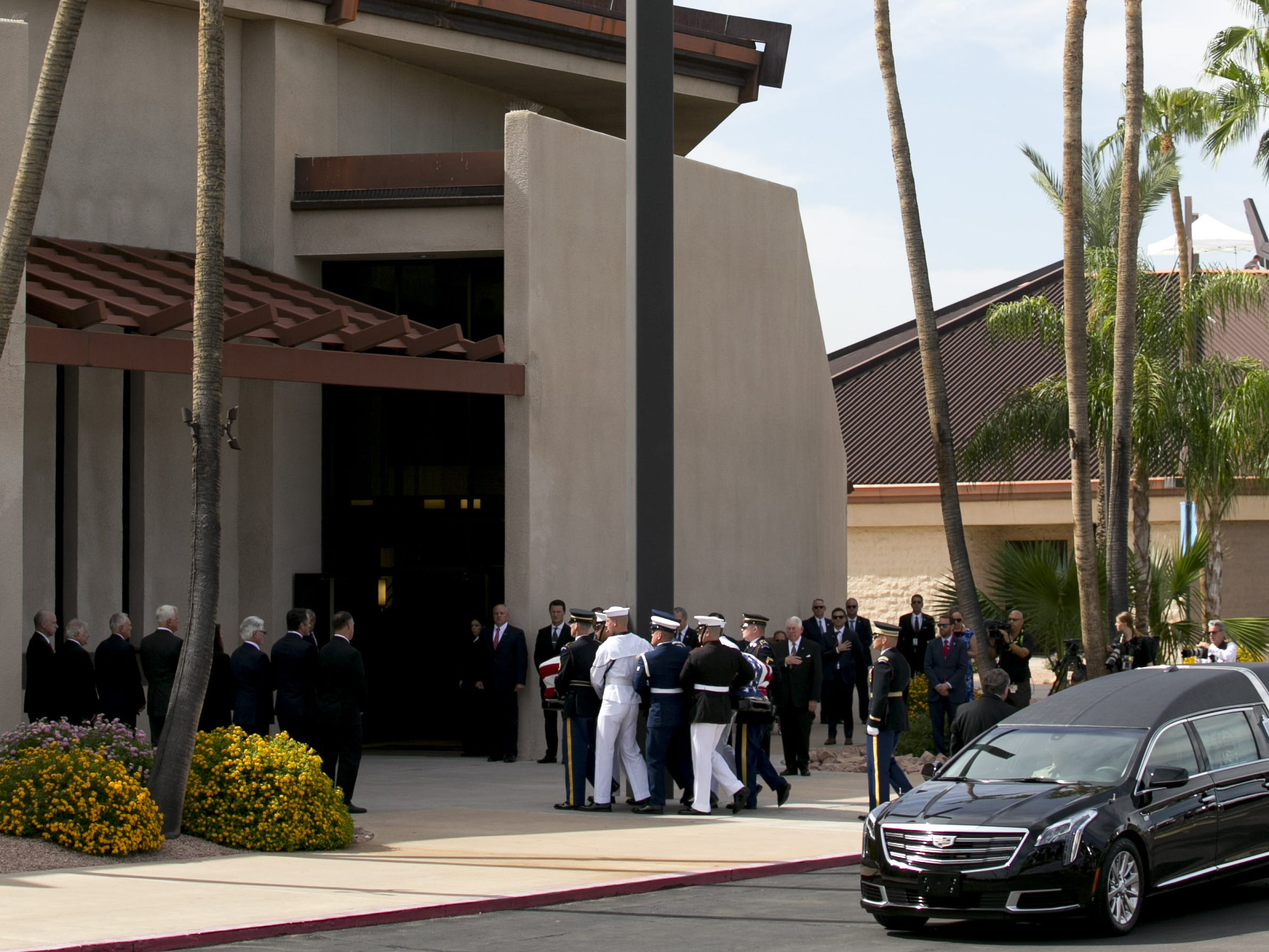 Senator John McCain's flag-draped casket is carried by members of the United States military during a memorial service for Senator John McCain at North Phoenix Baptist Church in Phoenix on Aug. 30, 2018.