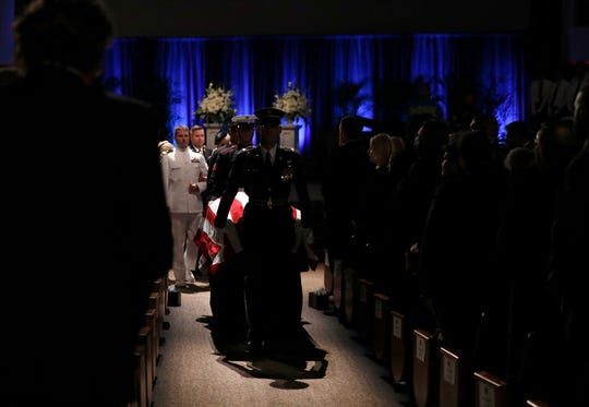 The honor guard moves the casket after memorial service for Sen. John McCain, R-Ariz. at the North Phoenix Baptist Church, Aug. 30, 2018, in Phoenix.