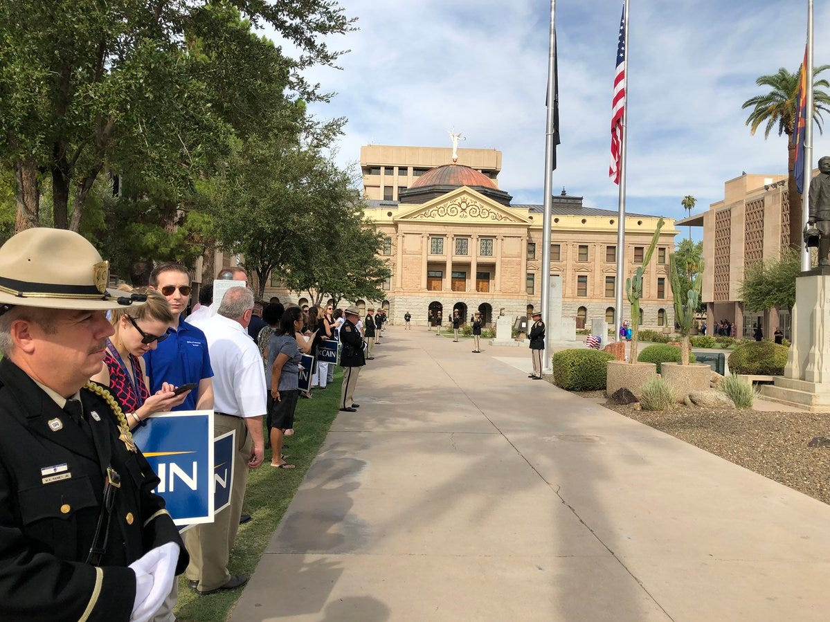 The scene outside the Capitol Aug. 30, 2018. Sen. John McCain will soon be carried by motorcade to North Phoenix Baptist Church.