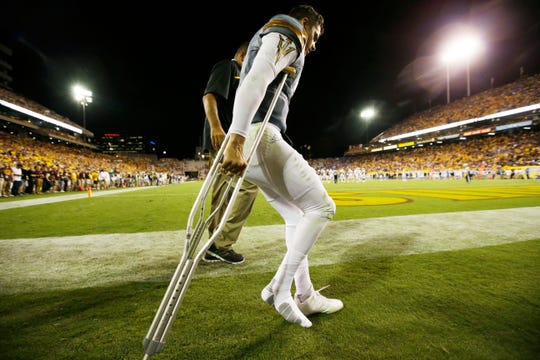 Arizona State quarterback Brady White leaves the game on crutches in the 4th quarter against UCLA on Saturday, Oct. 8, 2016 in Tempe, Ariz.