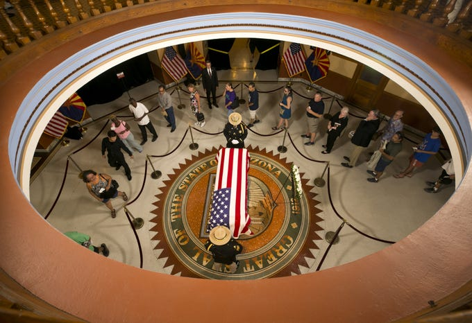People pay their respects as Senator John McCain lies in state at the Arizona Capitol in Phoenix on Wednesday, August 29, 2018.