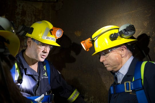 Sen. John McCain (right) talks with project director Andrew Taplin on Oct. 7, 2014, while riding the shaft 10 bucket 1,200 feet to the surface at Superior's Resolution Copper.