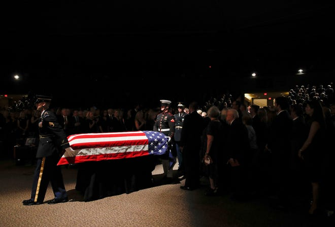 The military honor guard moves the casket into the North Phoenix Baptist Church for a memorial service for Sen. John McCain, R-Ariz. on Aug. 30, 2018, in Phoenix.