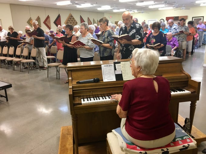 Edith Lively, who turned 100 this month, volunteers to play the piano at the Village Chapel in Mesa.