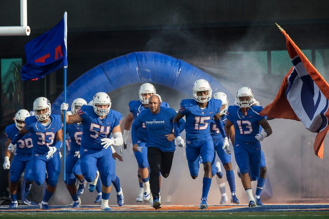 Bishop Gorman head coach Kenny Sanchez leads the Gaels onto the field before the start of their home matchup with Mater Dei on Friday, Aug. 24, 2018, at Bishop Gorman High School in Las Vegas.