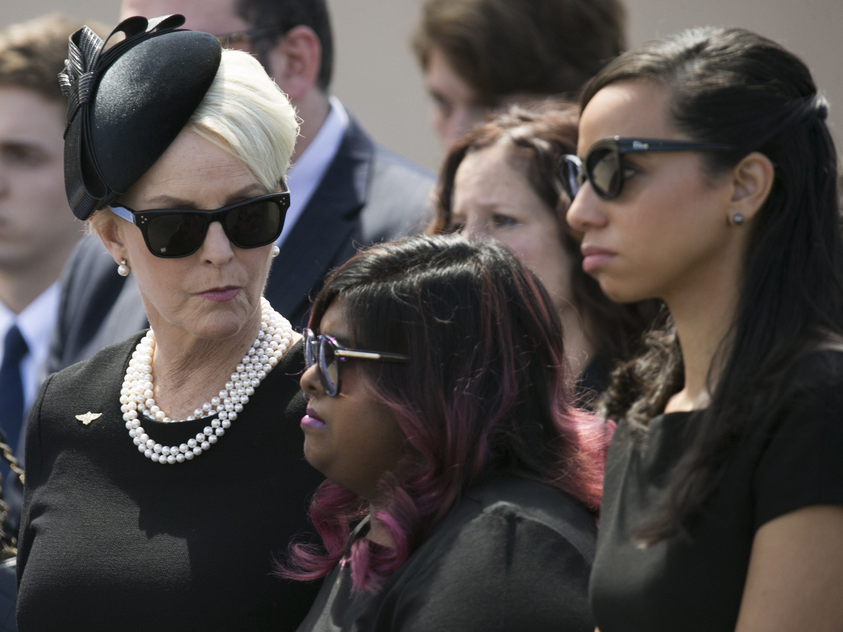 Cindy McCain looks at her daughter, Bridget McCain, following a memorial service for their husband and father, Senator John McCain at North Phoenix Baptist Church in Phoenix, Aug. 30, 2018.