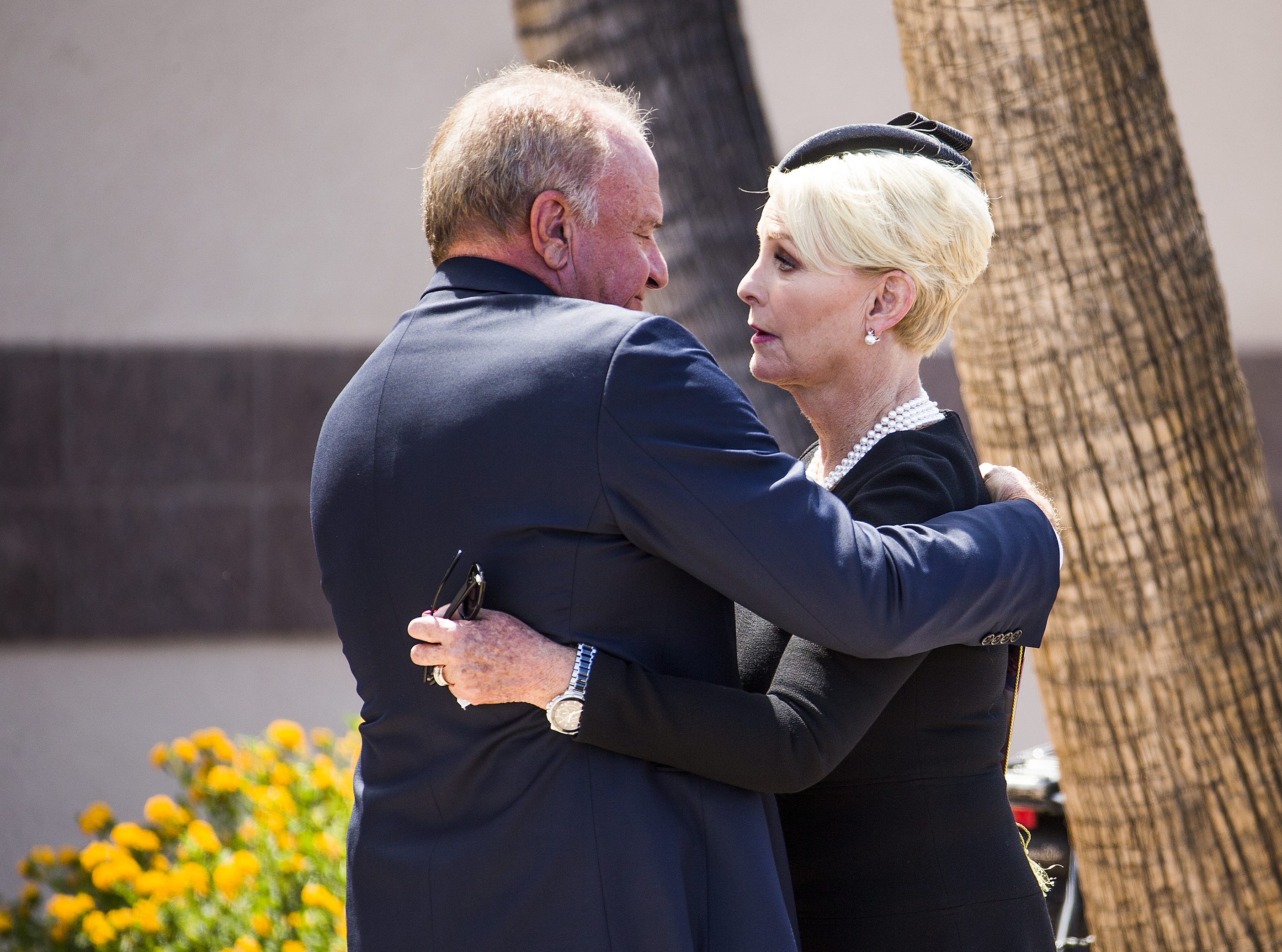 Former Arizona Attorney General Grant Woods says goodbye to Cindy McCain after a memorial service for Sen. John McCain at North Phoenix Baptist Church in Phoenix on Aug. 30, 2018.