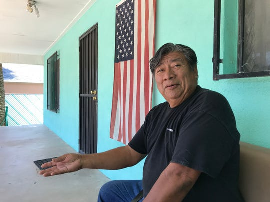 Pascual Ortiz, 63, lives in the shadow of the state Capitol and is proud to display his flag.