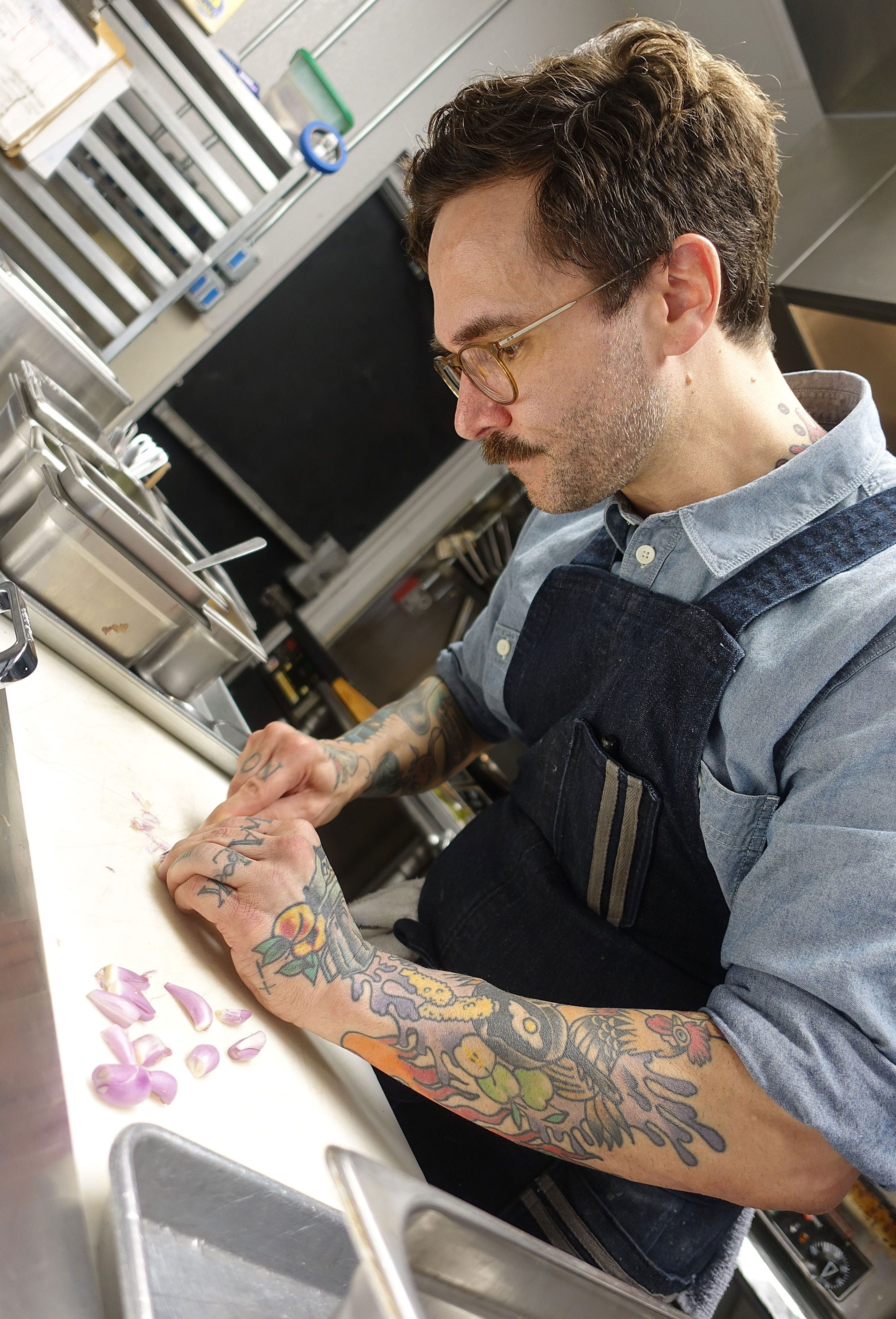 Jeff Kraus of Crepe Bar prepares a dish with i'itoi onions.