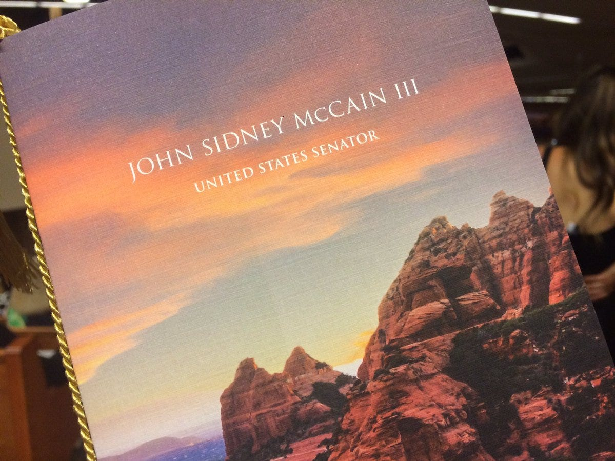 The cover of the program for Sen. John McCain's memorial service at North Phoenix Baptist Church. Former Vice President Joe Biden, 24 sitting U.S. senators and four former U.S. senators are expected to attend the service Thursday, Aug. 30, 2018.