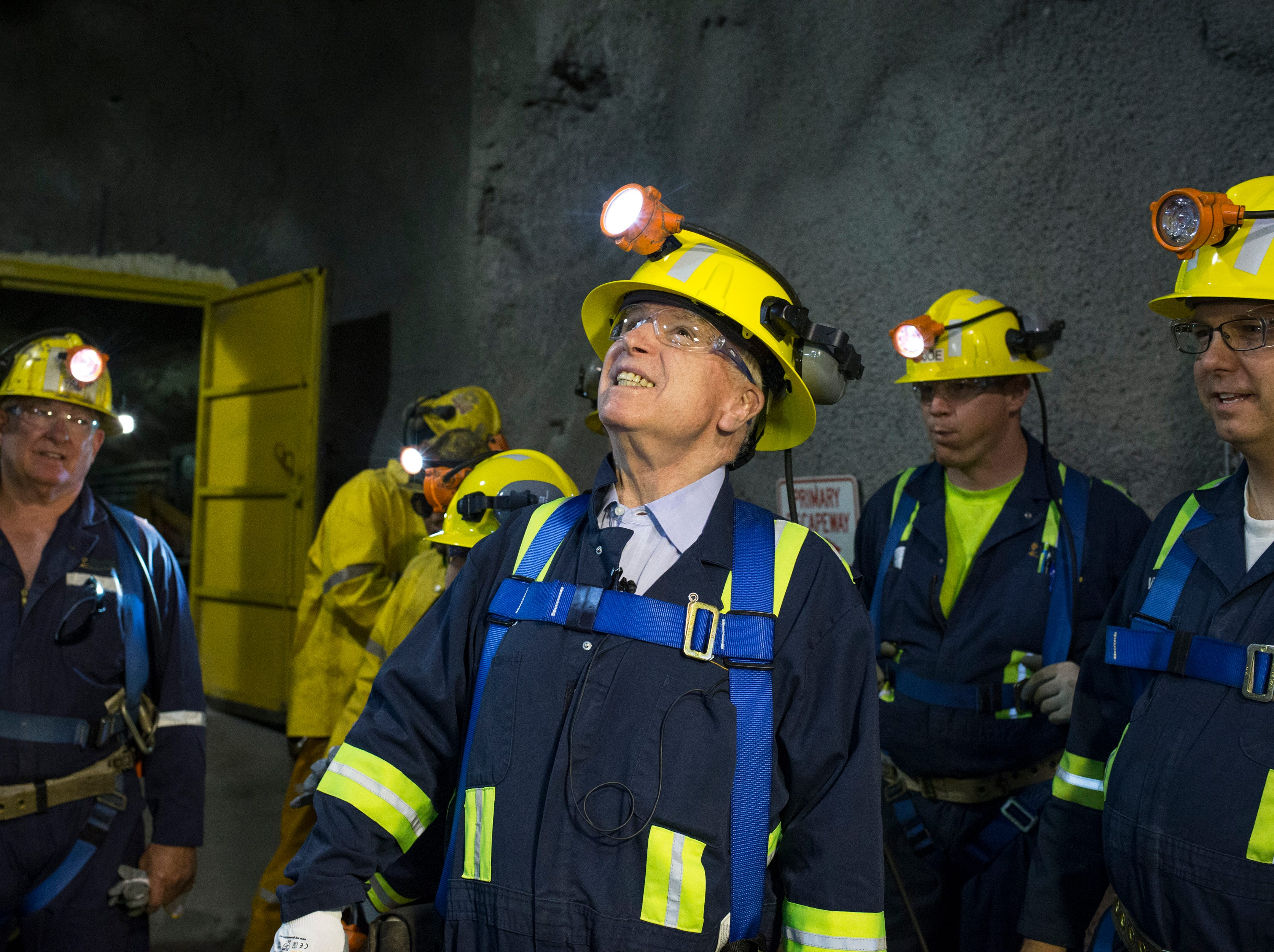 "Sen. John McCain (center) tours on Oct. 7, 2014, the ""never sweat tunnel,"" 1,200 feet below the surface in the East Plant at Superior's Resolution Copper."